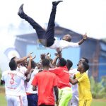 Kitara Football Club players and coaches celebrate promotion to the StarTimes Uganda Premier League